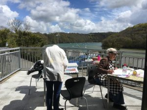 Two people painting in Malpas, Cornwall